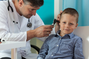Boy during ear examination