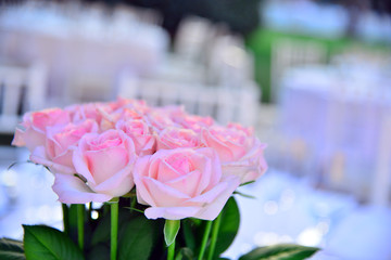Life event with pink bouquet of roses