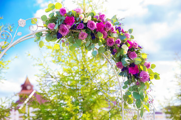 Arch for the wedding ceremony. Floristic composition in vintage
