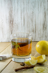 Cup of Healthy Tea over wood background
