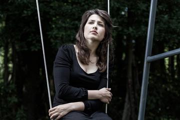 Sad woman on a swing