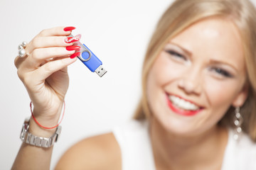 Smiling Woman With USB Memory In Hands