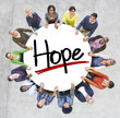 Group of People Holding Hands Around Letter Hope