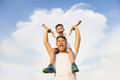 happy little boy  sitting on father's shoulder