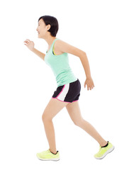 smiling young female runner isolated on white background