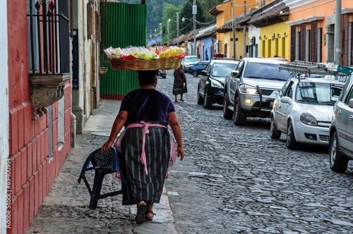 Traditional woman selling fruits in Antigua, Guatemala