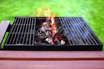 Flaming charcoal and BBBQ Grill