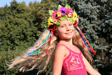 Smiling little girl in wreath