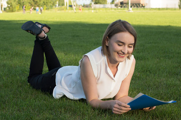 girl in the park with documents