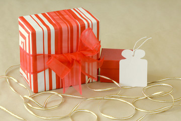 Red and white stripe gift with an empty tag
