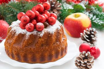 Christmas fruitcake on a plate, close-up