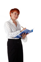 woman writes in office documents
