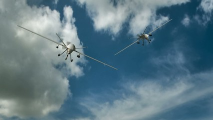 two armed predator drones in flight on the camera