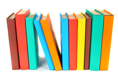 Multi-coloured books. On white background.
