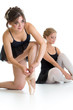 Two beautiful young girls preparing for dance training together