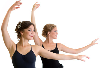 Two beautiful young girls making exercise or dancing together  i