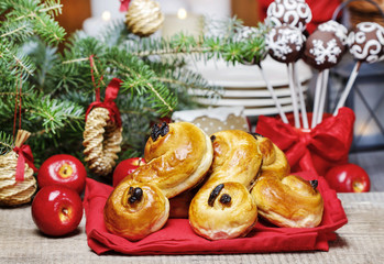 Traditional swedish buns in christmas setting. A saffron bun,