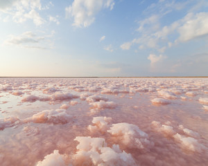 Pink salt lake, where salt is mined for food.
