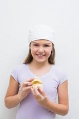 Little girl holding model teeth