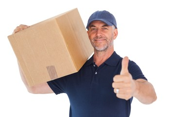Happy delivery man holding cardboard box showing thumbs up