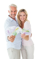 Happy couple flashing their cash