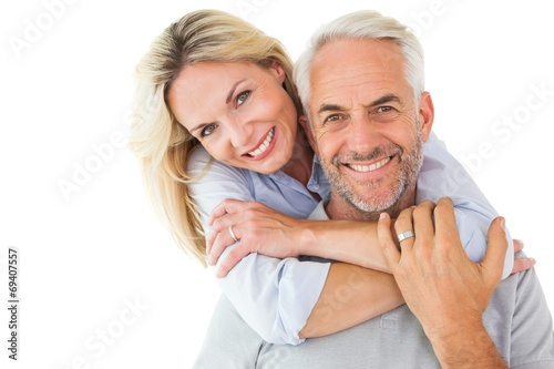 Leinwandbild Motiv Happy couple standing and hugging