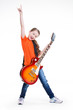 Cute girl plays on the electric guitar.