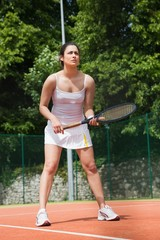 Pretty tennis player ready to play