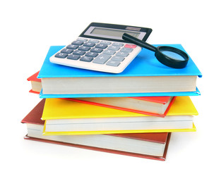 Books and school tools. On white background.