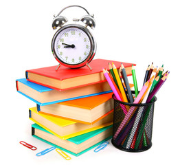 Books, an alarm clock and school tools.