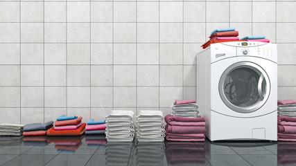 Pile of colorful towels on washing machine