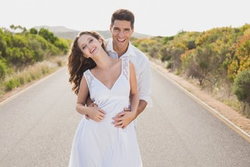 Loving couple standing on countryside road