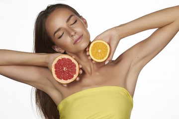 Beautiful sexy young woman with perfect healthy skin with citrus