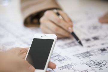 Mobile phone, pens, documents,Female hand