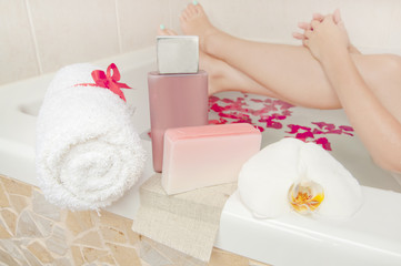 Bath time - cosmetics, towel and soap composition with woman bat