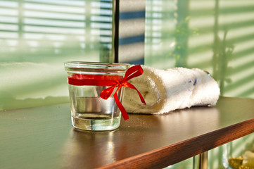 Spa and bauty salon detail - towel and candle holder. Indoor sho