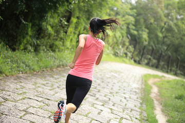 fitness woman runner running on stone trail