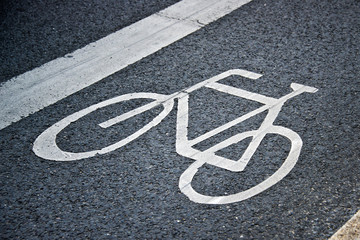 Bicycle lane sign on the ground