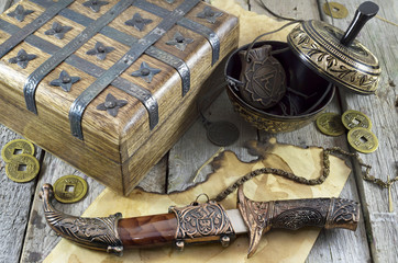 Wooden box, knife and medallions