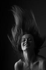 Happy beautiful woman shaking head; monochrome