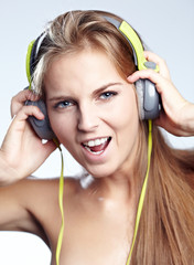 young blond woman listening to loud music