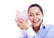 Happy woman shaking a piggy bank, isolated on white background