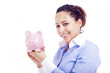 Happy woman holding a piggy bank, isolated on white background