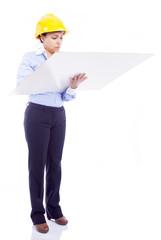 Female engineer analyzes a blueprints, isolated on white