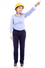 Female engineer pointing, isolated on white background