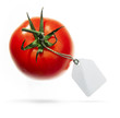 a red tomato with Sale Tags on a white background