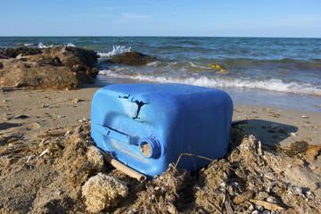 plastic fuel tank  on the beach