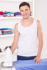 Man ironing shirt before leaving for work.