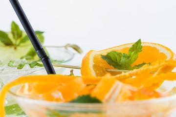 Orange and lime Mojito over white background