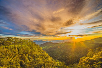 Sunset Over Mountain with Rain Forest